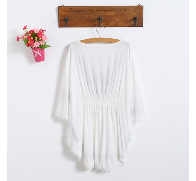 Блузка белая летучая мышь